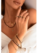 A celebrity chain with a black round pendant made of 316L stainless steel
